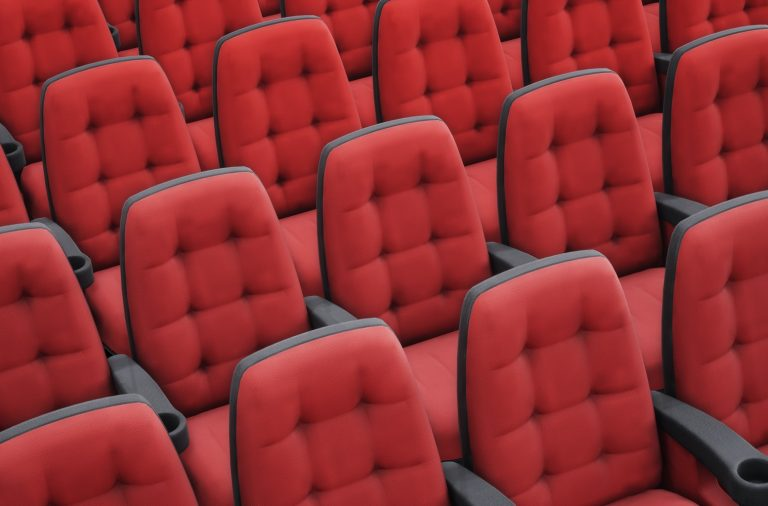 Empty red cinema chairs. Perspective view. 3d rendering image.