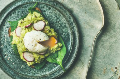 Healthy vegetarian wholegrain avocado toasts with poached egg, top view