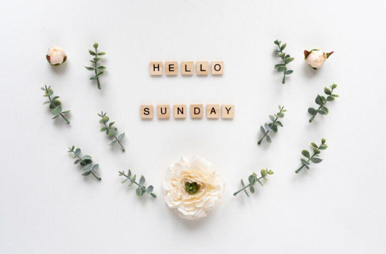 Hello Sunday words on white marble background
