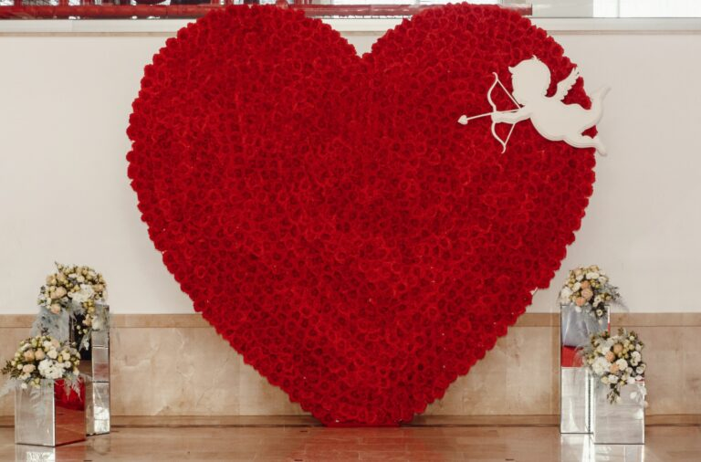 luxury red heart of roses and cupid with arrows at wedding reception