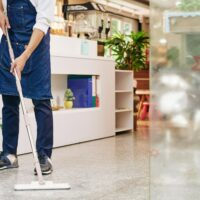 Waiter wiping floor