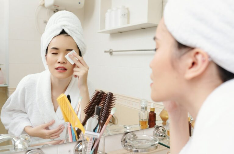 Woman wiping off eye make-up