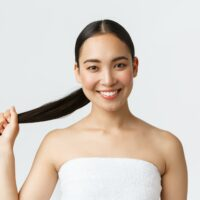 Beauty, hair loss products, shampoo and hair care concept. Close-up of beautiful asian woman in bath