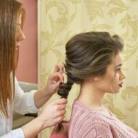 Hairdresser making braid